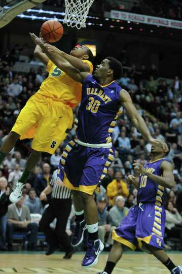 Siena's Evan Hymes is fouled by UAlbany's Jayson Guerrier near the end of Siena's 64-60 victory at t