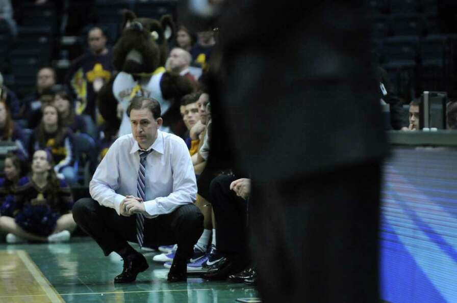 UAlbany men's basketball coach Will Brown quietly watches from the sidelines near the end of their 6