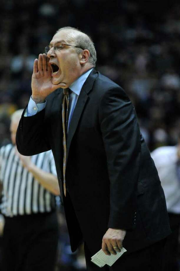 Siena men's basketball coach Mitch Buonaguro calls out instructions to his team during the second half of their 64-60 win over UAlbany at the Times Union Center on Monday night Dec. 5, 2011 in Albany, NY.   (Philip Kamrass / Times Union ) Photo: Philip Kamrass / 10015374A