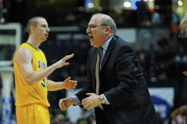 Siena men's basketball coach Mitch Buonaguro celebrates near the end of the second half of their 64-60 win over UAlbany at the Times Union Center on Monday night Dec. 5, 2011 in Albany, NY.  Siena's Owen Wignot is at left.  (Philip Kamrass / Times Union ) Photo: Philip Kamrass / 10015374A