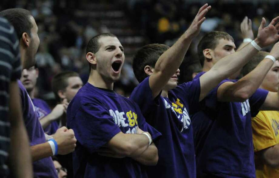 UAlbany students Wyatt Kresin, left, Tom Pepe and Phil Canale cheer on their team during the first half of their  64-60 loss to Siena at the Times Union Center on Monday night Dec. 5, 2011 in Albany, NY.  (Philip Kamrass / Times Union ) Photo: Philip Kamrass / 10015374A