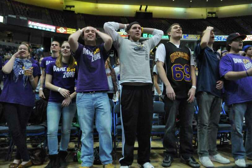 UAlbany students disagree with a call during the first half of their team's 64-60 loss to Siena at t