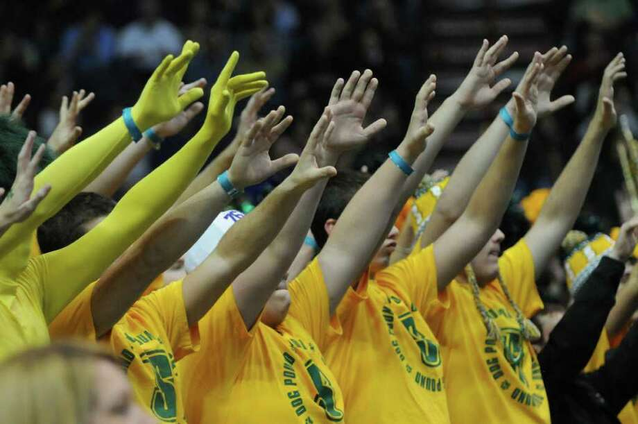 Siena fans celebrate during the second half of their team's 64-60 win over UAlbany at the Times Union Center on Monday night Dec. 5, 2011 in Albany, NY.  (Philip Kamrass / Times Union ) Photo: Philip Kamrass / 10015374A