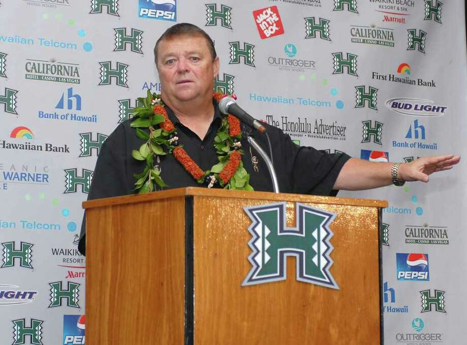 Hawaii new football head coach Greg McMackin responds to a question during a news conference, Wednesday, Jan. 16, 2008, in Honolulu. (AP Photo/Ronen Zilberman) Photo: RONEN ZILBERMAN / AP