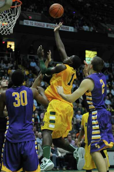 Siena's OD Anosike drives to the basket during the second half of their 64-60 victory over UAlbany a