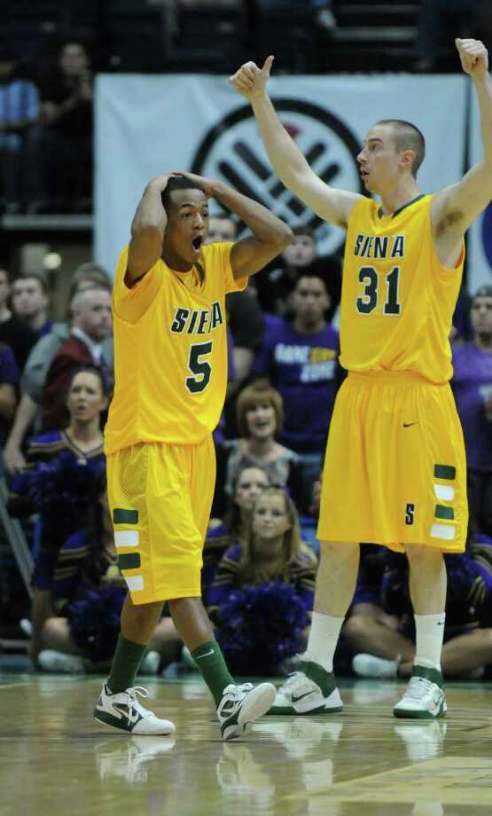 Siena's Evan Hymes doesn't like a call during the second half of their 64-60 victory over UAlbany at the Times Union Center on Monday night Dec. 5, 2011 in Albany, NY.   Owen Wignot is at right.  (Philip Kamrass / Times Union ) Photo: Philip Kamrass / 10015374A