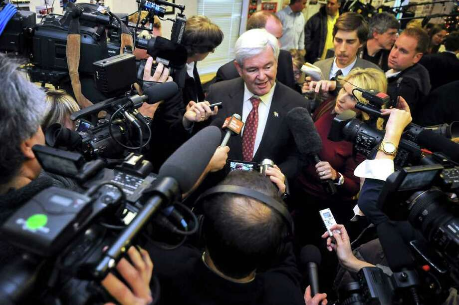 FILE - In this Nov. 30, 2011 file photo, Republican presidential candidate, former House Speaker Newt Gingrich speaks at Tommy's Ham House in Greenville ,  S.C.  For three decades, the Republican who won South Carolina's presidential primary has also won the GOP nomination. That strong record helps explain why Gingrich is working more aggressively than any of his competitors to organize activists and volunteers ahead of the Jan. 21 primary. His chief rival, Mitt Romney, is approaching South Carolina tentatively. (AP Photo/Richard Shiro, File) Photo: Richard Shiro