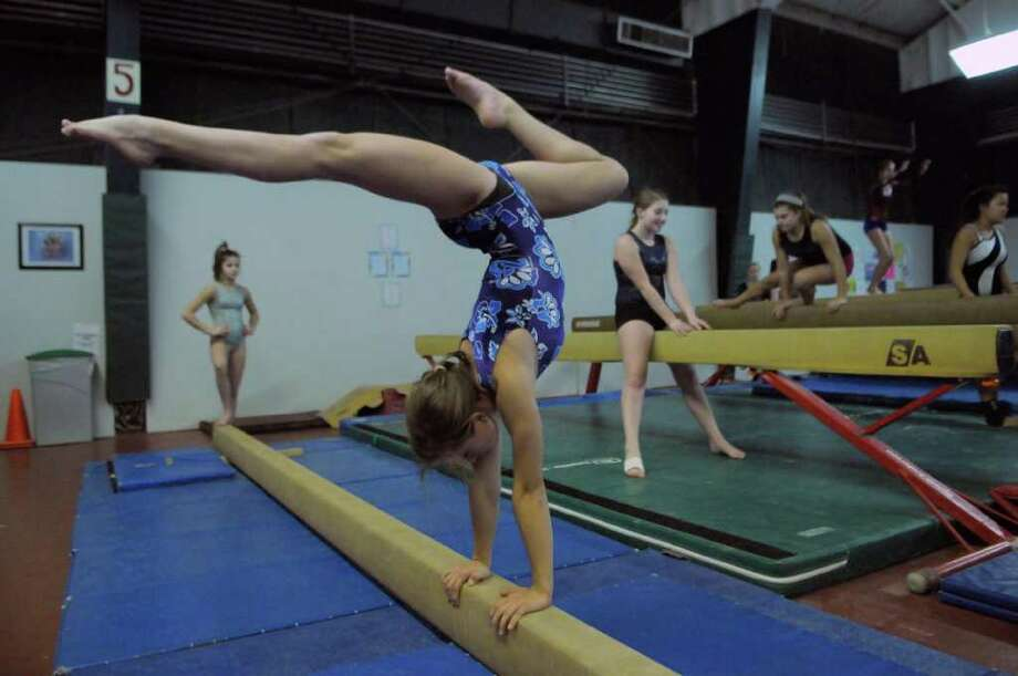 Saratoga Springs High School gymnast Caroline Green works out with teammates at the Wilton branch of the Saratoga Regional YMCA on Monday Dec. 5, 2011 in Wilton, NY.  (Philip Kamrass / Times Union ) Photo: Philip Kamrass / 00015662A