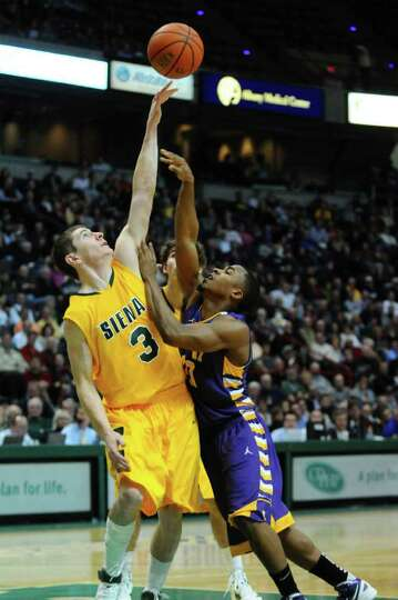 Siena's Kyle Downey defends UAlbany's Mike Black during the first half of their 64-60 victory over U