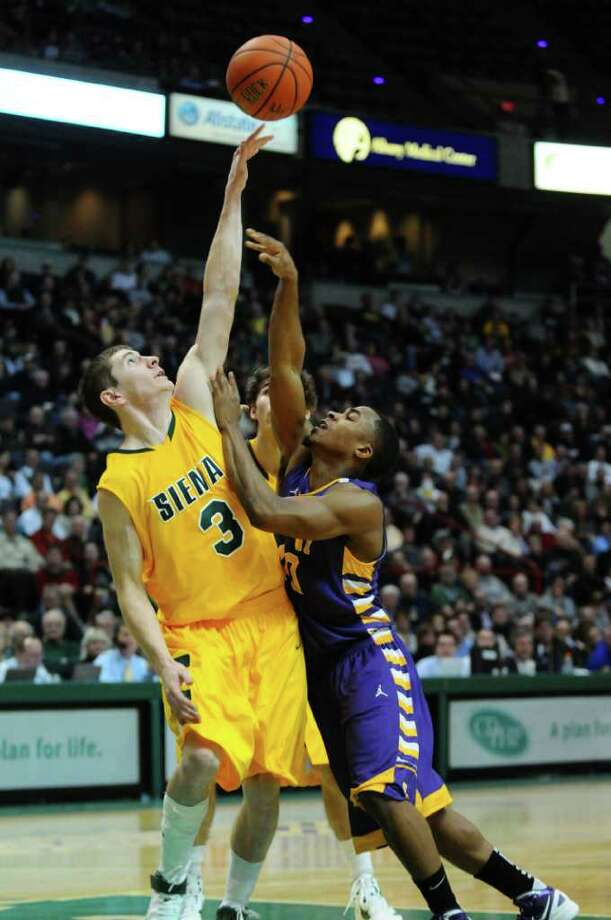 Siena's Kyle Downey defends UAlbany's Mike Black during the first half of their 64-60 victory over UAlbany at the Times Union Center on Monday night Dec. 5, 2011 in Albany, NY.  (Philip Kamrass / Times Union ) Photo: Philip Kamrass / 10015374A