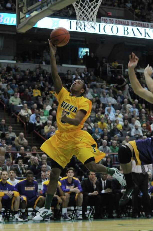 Siena's Evan Hymes drives to the basket during the first half of their 64-60 victory over UAlbany at the Times Union Center on Monday night Dec. 5, 2011 in Albany, NY.  (Philip Kamrass / Times Union ) Photo: Philip Kamrass / 10015374A