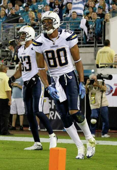 MIKE EHRMANN: GETTY IMAGES FEELING IT: San Diego receiver Malcom Floyd (80) celebrates his 52-yard scoring catch in the third quarter. Photo: Mike Ehrmann / 2011 Getty Images