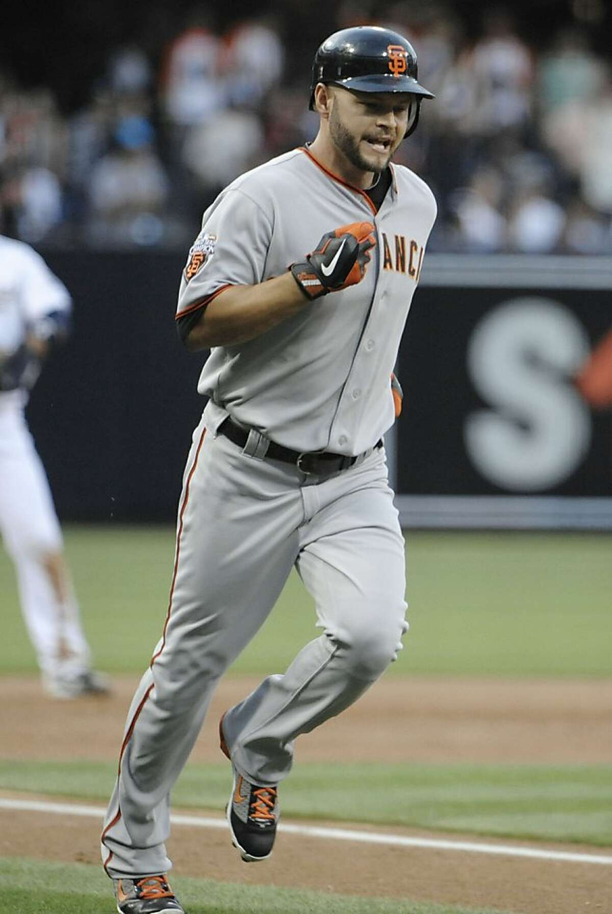 SAN DIEGO, CA - JULY 15: Cody Ross #13 of the San Francisco Giants rounds the bases after hitting a solo home run during the second inning of a baseball game against the San Diego Padres at Petco Park on July 15, 2011 in San Diego, California. (Photo by Denis Poroy/Getty Images) Ran on: 07-16-2011 Cody Ross trots around the bases after a solo homer that put the Giants up 2-0.