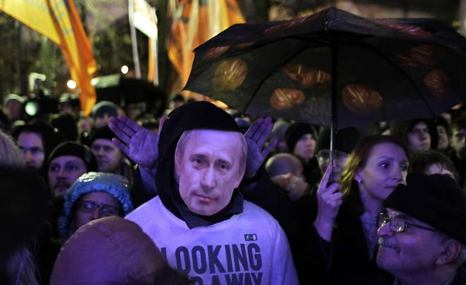 A man wearing a Vladimir Putin mask attends a rally in Moscow, Monday, Dec. 5, 2011. Several thousand people have protested in Moscow against Prime Minister Vladimir Putin and his party, which won the largest share of a parliamentary election that observers said was rigged. A group of several hundred then marched toward the Central Elections Commission near the Kremlin, but were stopped by riot police and taken away in buses. (AP Photo/Sergey Ponomarev) Photo: Sergey Ponomarev, AP
