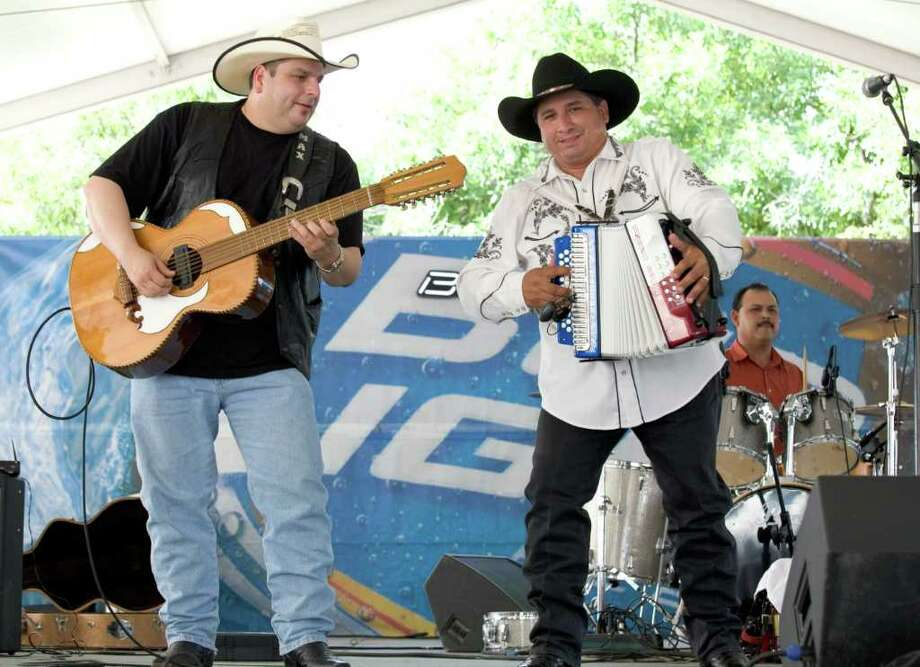 Grammy-winning conjunto rock 'n' rollers Los TexManiacs, with Max Baca (left) and David Farias, will perform at Pueblo Hall on Friday. Photo: EXPRESS-NEWS FILE PHOTO / SAN ANTONIO EXPRESS NEWS