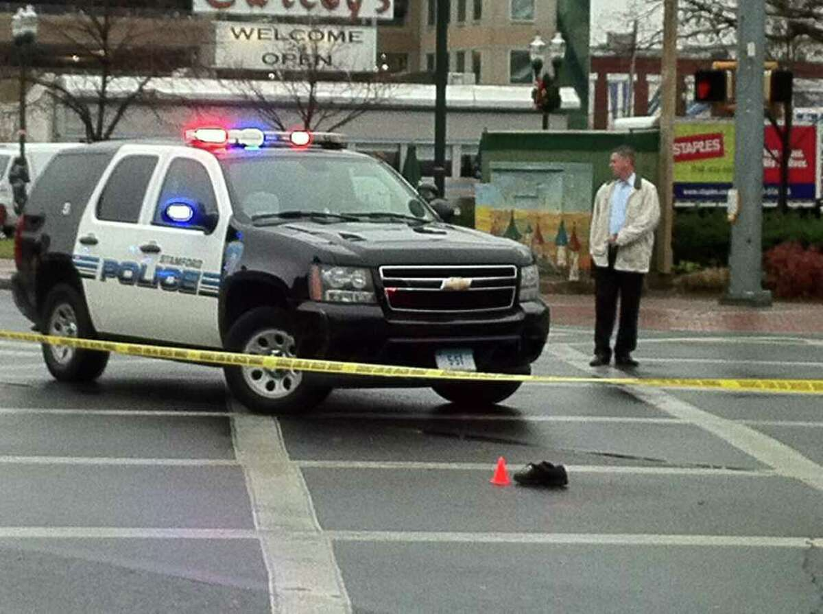 Stamford police investigate an accident in which an elderly man suffered a serious head injury after being struck by a vehicle on Main Street near Columbus Park.