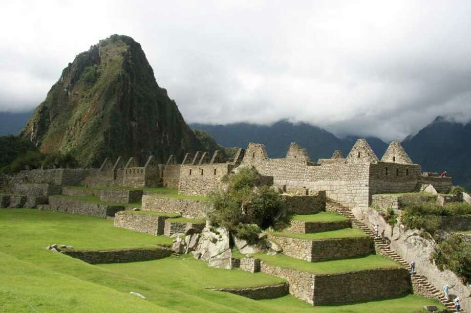 FOR TRAVEL Overlooked by the Spanish who conquered the Incas in the early 16th Century, Machu Picchu was largely unknown to westerners until American adventurer Hiram Bingham explored it in 1911, and then wrote a book about the lost Inca city. Photo by Susana Hayward Photo: SUSANA HAYWARD, FOR THE EXPRESS-NEWS