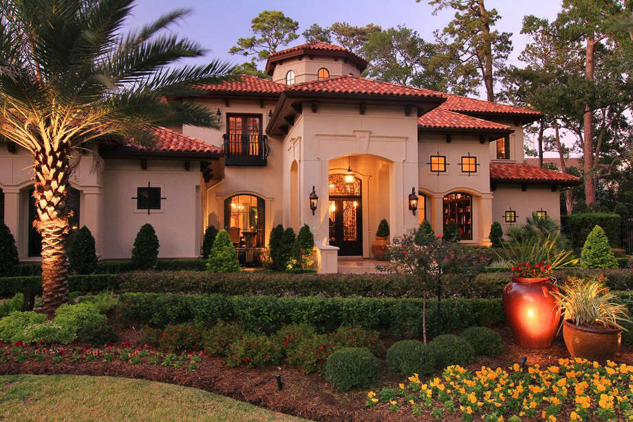 An external view of the home, highlighting the yard's exquisite landscaping. Photo: Realtor.com