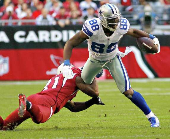 Dallas Cowboys wide receiver Dez Bryant (88) is tackled by Arizona Cardinals cornerback Patrick Peterson (21) during the first half of an NFL football game, Sunday, Dec. 4, 2011, in Glendale, Ariz. Photo: AP