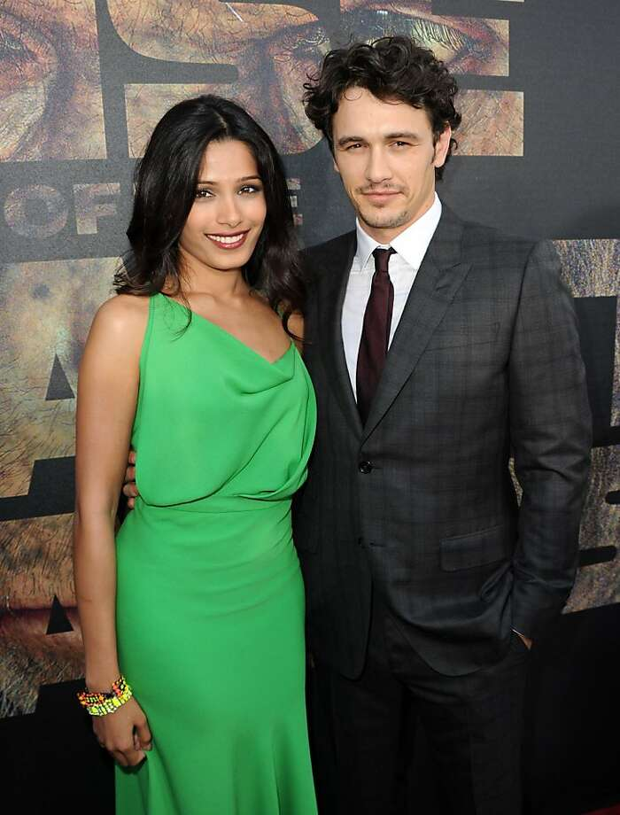 "LOS ANGELES, CA - JULY 28:  Actress Freida Pinto (L) and actor James Franco arrive at the premiere of 20th Century Fox's ""Rise Of The Planet Of The Apes"" held at Grauman's Chinese Theatre on July 28, 2011 in Los Angeles, California. Photo: Kevin Winter, Getty Images"