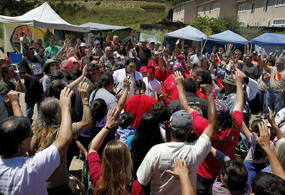 Hundreds held their hands up as the drums played during a ceremony for the honorees. A celebration was held at Glen Cove Park in Vallejo, Calif Saturday July 30, 2011 by a group of determined Native Americans and their supporters who stopped the city of Vallejo from disturbing a sacred burial ground. Photo: Brant Ward, The Chronicle