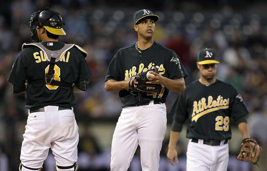 Oakland Athletics' Gio Gonzalez, center, is visited on the mound by Kurt Suzuki, left, and Scott Sizemore (29) during the fifth inning of a baseball game against the Minnesota Twins Friday, July 29, 2011, in Oakland, Calif. Photo: Ben Margot, AP