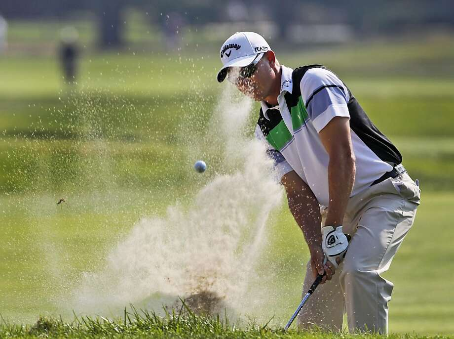 Derek Lamely blasts out of the sand on the 17th hole during the second round of the Greenbrier Classic golf tournament at the Greenbrier Resort in White Sulphur Springs, W.Va., Friday, July 29, 2011. Lamely shot an even par 70 leaving him at 5-under for the two rounds. Photo: Steve Helber, AP