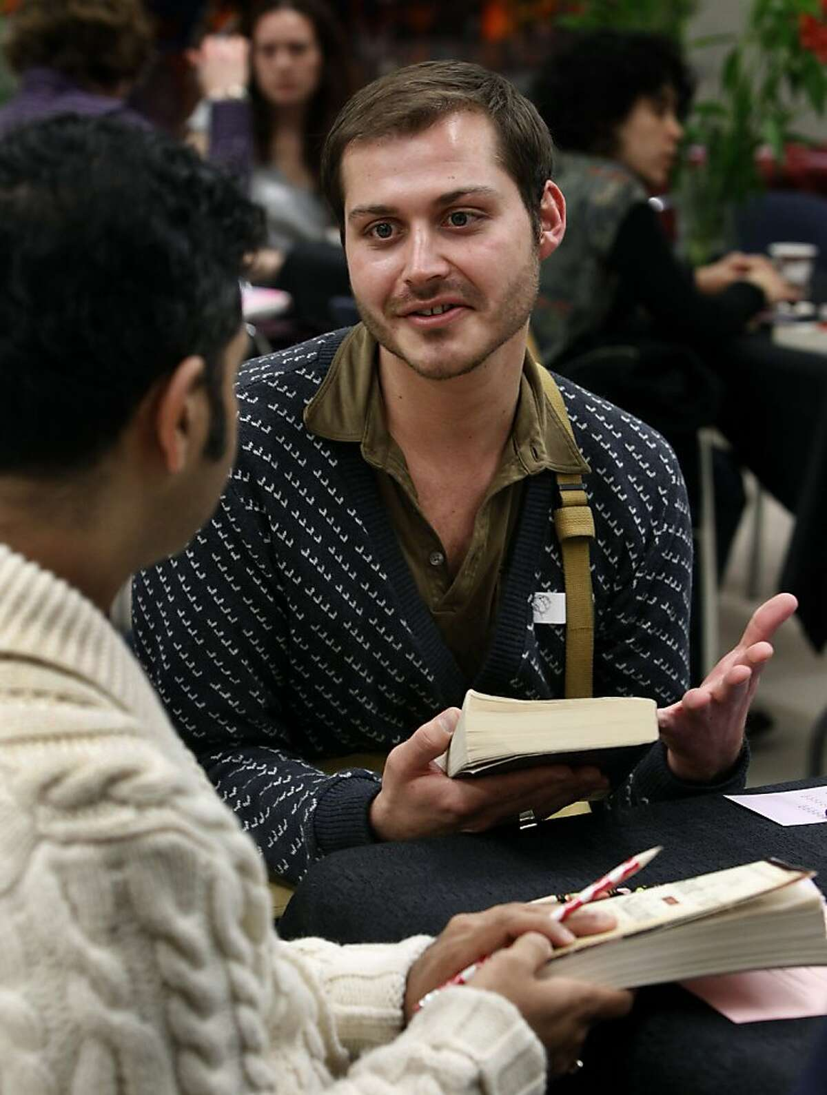Blake Love meets Ameet Kamath (left) at an LGBT speed dating event at the Main Library in San Francisco, Calif., on Wednesday, Feb. 2, 2011. Participants were encouraged to bring their favorite book as a conversation starter.