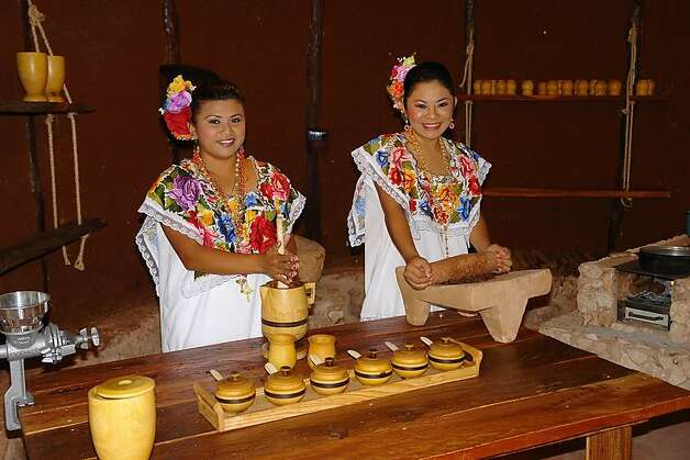 Museum employees demonstrate the traditional processing of cocoa beans. Photo: Ecomuseo Del Cacao