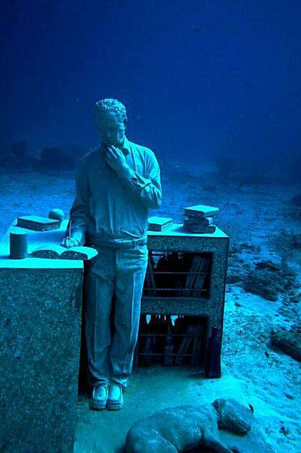 """Dream Collector"" sculpture at the world's largest underwater sculpture park. Photo: Cancun CVB"