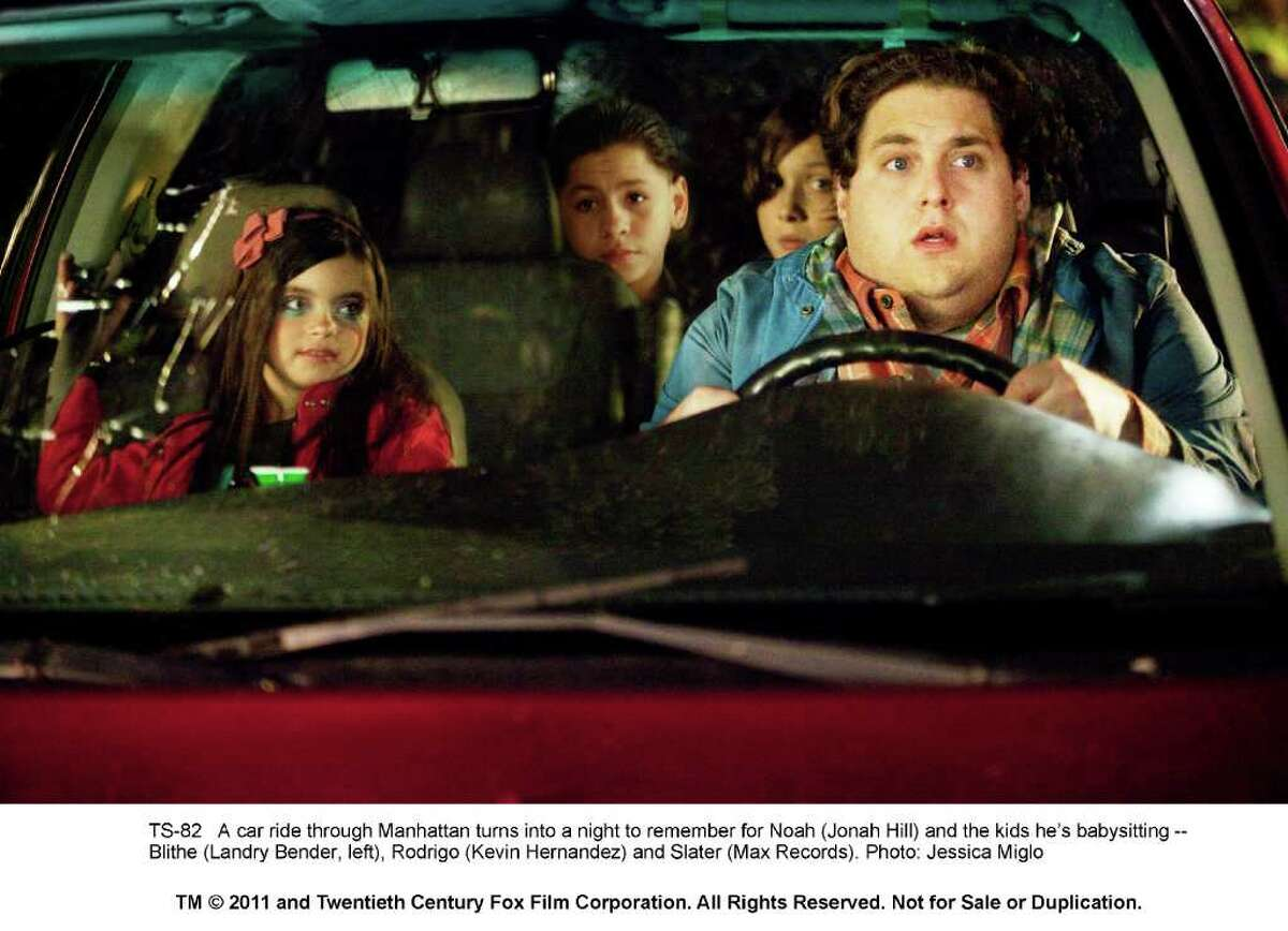 Driver Jonah Hill and the kids, Landry Bender (left), Kevin Hernandez and Max Records, take a fateful spin.
