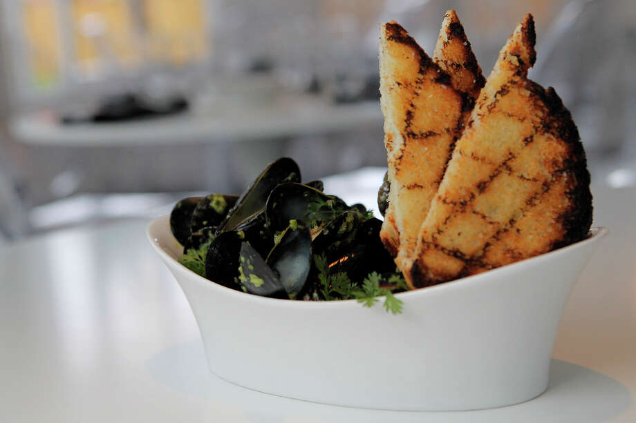 Prince Edward Island mussels with green harissa, cilantro, white wine, jalapeno and grilled bread at Feast (1024 S. Alamo St.) on Friday, Dec. 2, 2011. EDS NOTE: THERE IS A TILDE (~) OVER THE 'N' IN 'JALAPENO.' MICHAEL MILLER / mmiller@express-news.net Photo: MICHAEL MILLER, SAN ANTONIO EXPRESS-NEWS / mmiller@express-news.net