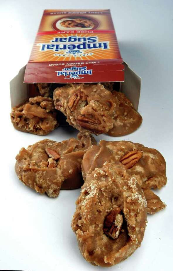 JOHNNY HANSON : STAFF PECAN TREATS: You need little more than brown sugar, cream and a candy thermometer to make these tasty Pralines. Photo: Johnny Hanson / © 2011 Houston Chronicle