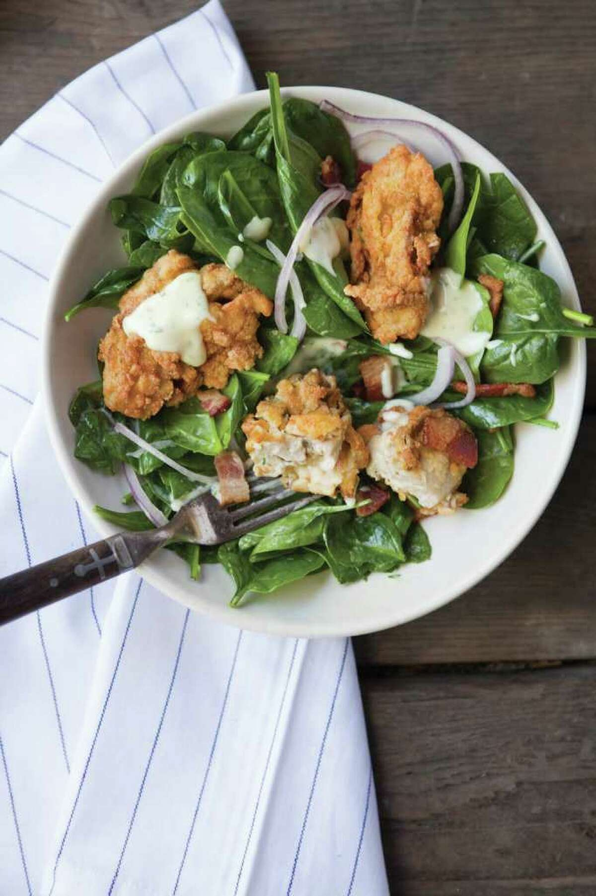 Get the recipe: Fried oysters with spinach salad and herbsaint dressing