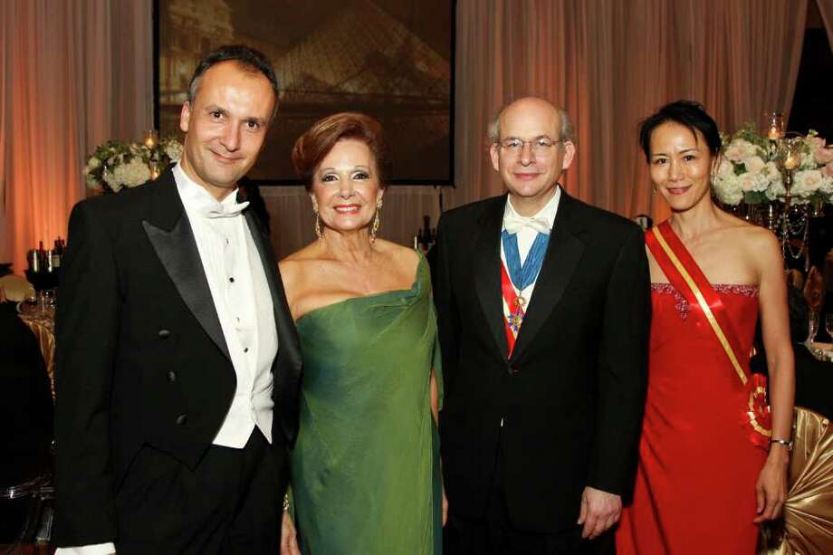 French Consular General Frederic Bartems, from left, Philamena Baird, David Leebron and Y. Ping Sun Photo: Kim Coffman