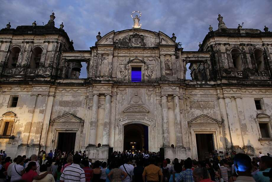 People gather in front of the Cathedral of Leon, or Basilica de la Asuncion, during celebrations of the cathedral's inclusion to the United Nations Educational, Scientific, and Cultural Organization (UNESCO) list of World Heritage Sites, in Leon, Nicaragua, Sunday July 24, 2011. The cathedral, which houses the tomb of modernist poet Ruben Dario, is one of four new sites inscribed in June to UNESCO's list that include natural wonders and historic and culturally important landmarks. Photo: Esteban Felix, AP