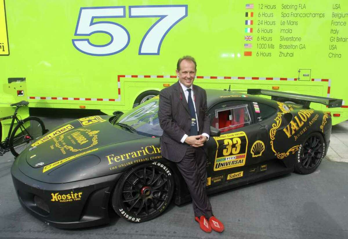 (For the Chronicle/Gary Fountain, November 20, 2011) Host Franco Valobra with his 430 Challenge Ferrari at the Ferrari Festival at Highland Village.