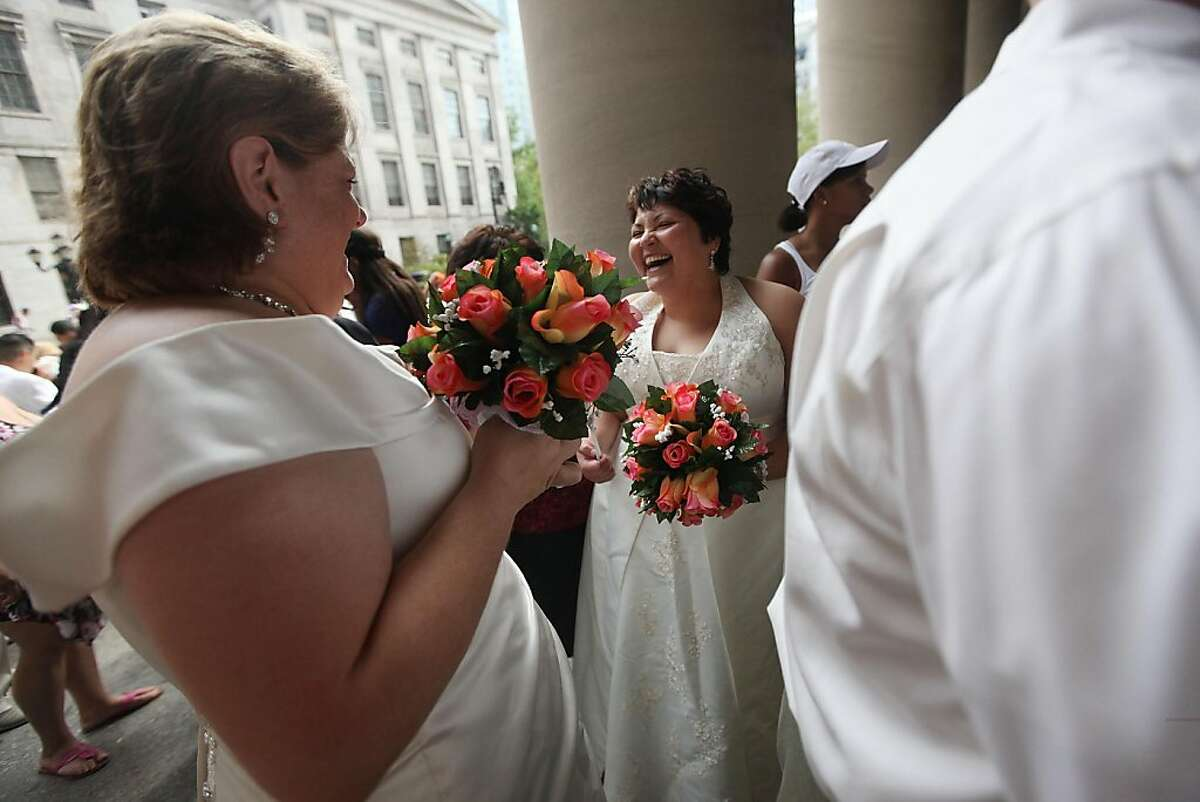 NEW YORK, NY - JULY 24: Barbara Tremblay (R) and Stacey Minondo wait on line to get married at the Brooklyn City Clerk's office on July 24, 2011 in New York City. Today was the first day gay couples were allowed to legally marry in New York state after Gov. Andrew Cuomo signed the historic legislation into law.