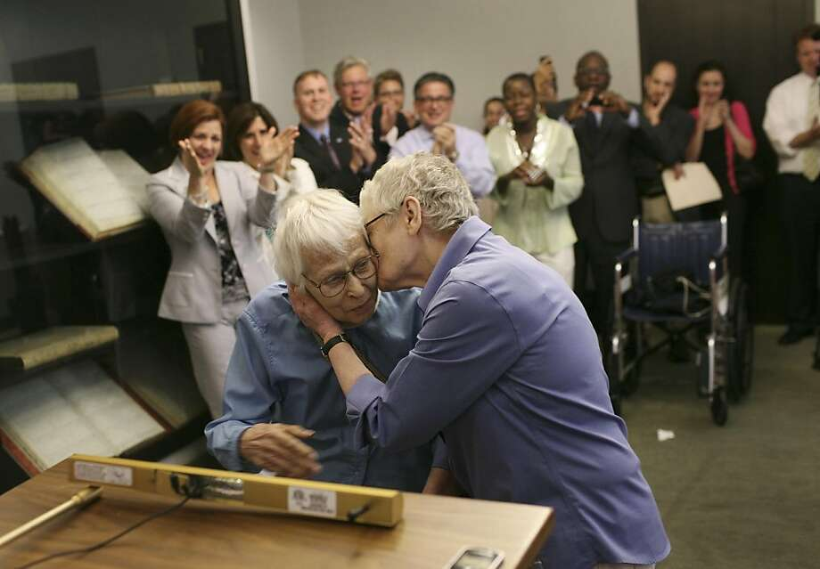 Phyllis Siegel, 76, right kiss her partner, Connie Kopelov, 84, after exchanging vows at Manhattan's City Clerk's office with New York City Council Speaker Christine Quinn, back left, in attendance, on the first day of same-sex marriage in New York, July 24, 2011. Hundreds of gay and lesbian couples across New York State began marrying on Sunday in the culmination of a long battle in the Legislature and a new milestone for gay rights advocates seeking to legalize same-sex marriage across the nation. (Michael Appleton/The New York Times) Photo: Michael Appleton, NYT