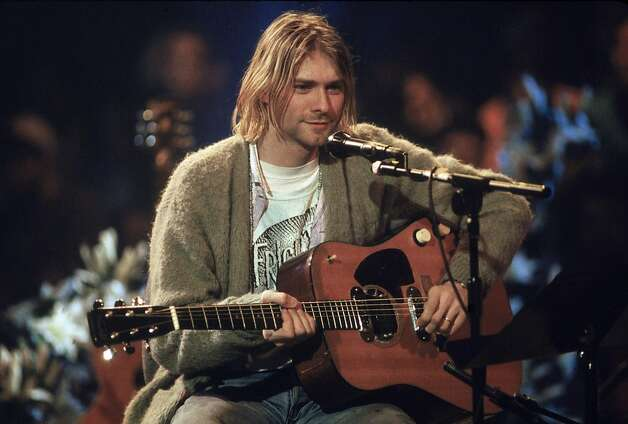"American singer and guitarist Kurt Cobain (1967 - 1994), performs with his group Nirvana at a taping of the television program ""MTV Unplugged,"" in New York, New York, November 18, 1993. Photo: Frank Micelotta, Getty Images"
