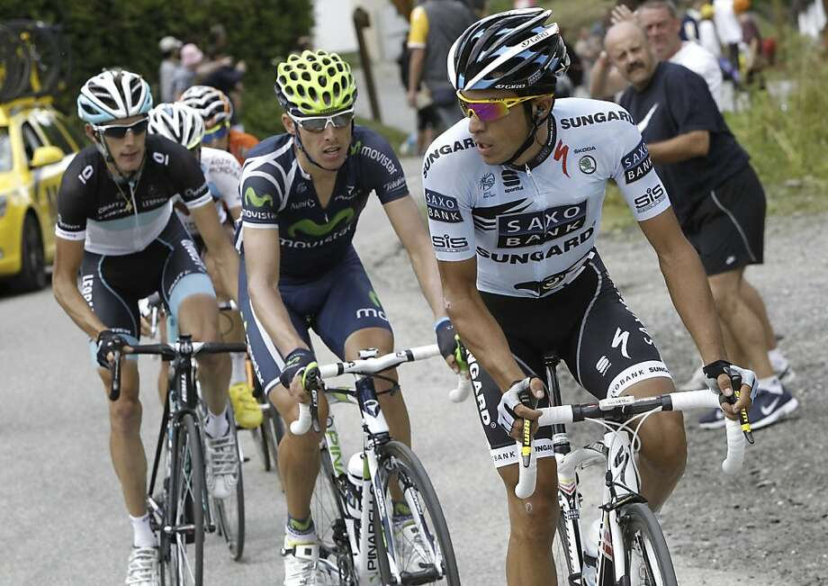 Three-time Tour de France winner Alberto Contador of Spain, right, Rui Alberto Costa of Portugal, center, and Andy Schleck of Luxembourg, left, climb Telegraphe pass during the 19th stage of the Tour de France cycling race over 109.5 kilometers (86 miles)starting in Modane Valfrejus and finishing on Alpe d'Huez, Alps region, France, Friday July 22, 2011. Photo: Laurent Cipriani, AP