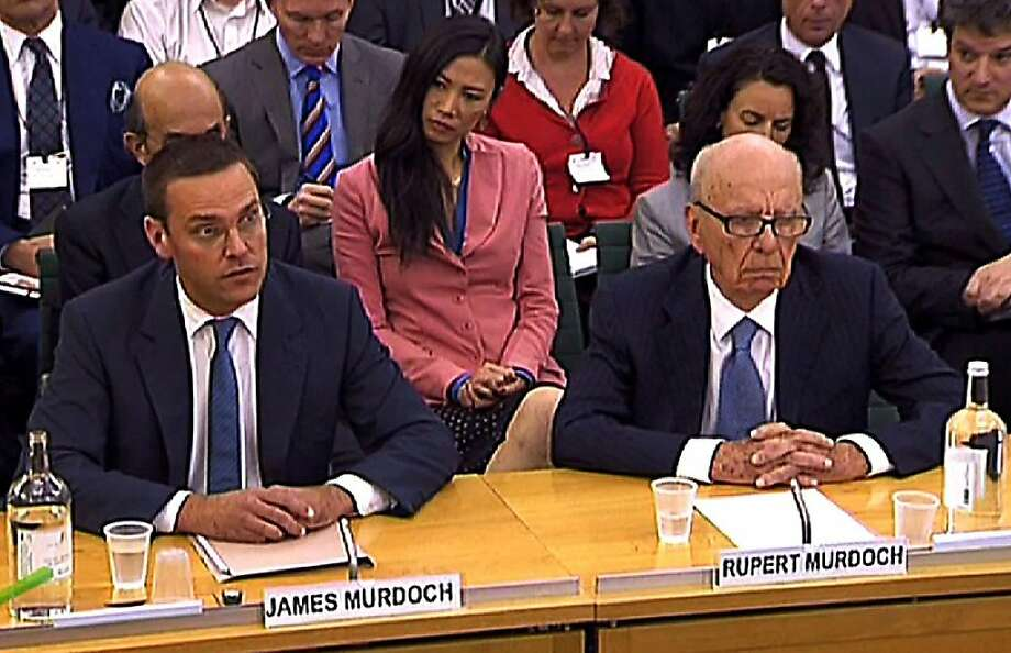 "A screen grab image taken in London on July 19, 2011, shows News Corporation Chief Rupert Murdoch (Front R) and his son James (Front L) giving evidence to a Parliamentary Select Committee on the phone hacking scandal. A protester hit Rupert Murdoch with a foam pie Tuesday as the media mogul testified to British lawmakers on the phone-hacking scandal, in a bizarre finale to what he called the ""most humble day of my life."" Photo: Parbul, AFP/Getty Images"