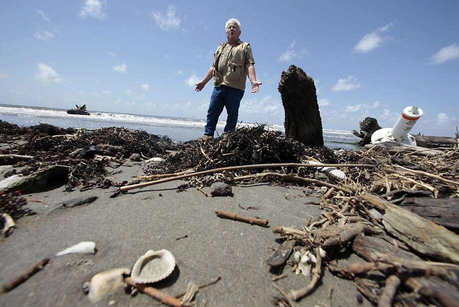 Forrest Travirca III, walks along Port Fourchon Beach as he searches for artifacts from Pre-historic American-Indian settlements in Caminada Headland, La., Tuesday, June 28, 2011. The sites were discovered last summer during the intense cleanup of the headlandÍs beaches after the BP oil spill. Since then, archeologists have found human and animal bones, fragments of pottery, primitive weapons and other items scattered over the beaches here. Archaeologists say the sites date to at least 700 A.D., well before European contact in the 1500s. Photo: Gerald Herbert, AP