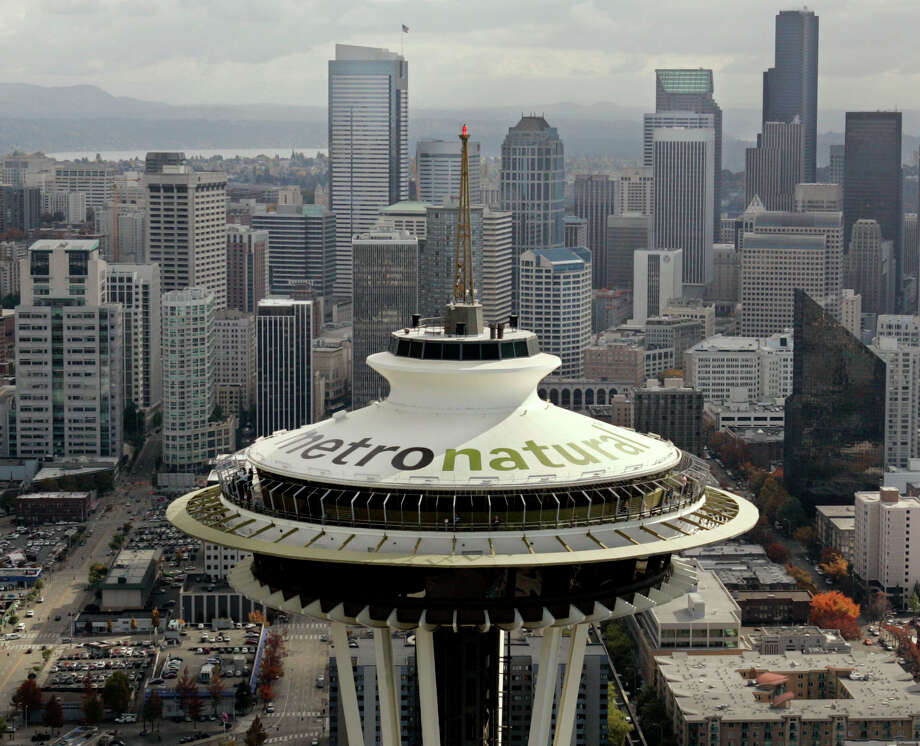 "Letters 18-feet tall proclaiming Seattle's newest tourism slogan, ""metronatural,"" are seen atop the landmark Space Needle on Oct. 20, 2006. The new tagline had been unveiled earlier in the day by the Seattle Convention and Visitors Bureau to promote the city."