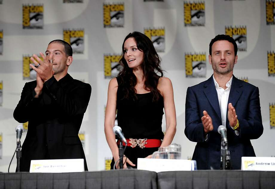 """John Bernthal, left, Sarah Wayne Callies, center, and Andrew Lincoln are shown at a panel for the television series """"The Walking Dead"""" at Comic-Con International 2011 in San Diego Friday, July 22, 2011. The annual comic book and popular arts convention attracts over 100,000 people and runs through Sunday. Photo: Denis Poroy, AP"""