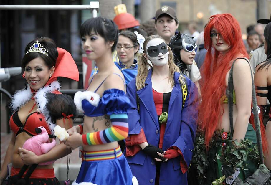 Costumed characters wait in line for a photo shoot in downtown San Diego near the Comic-Con International 2011 convention held in San Diego Thursday, July 21, 2011. The annual comic book and popular arts convention attracts over 100,000 people and runs through Sunday July 24. Photo: Denis Poroy, AP