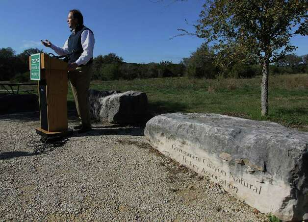 Addressing media at Government Canyon State Park, Carter Smith, Texas Parks and Wildlife excecutive director, makes a plea for for people to use the state parks and for donations. Stricken by drought and wildfires this past year, state parks have suffered from the lack of visitors. Smith said revenues have declined 25 percent from last year. Kin Man Hui/kmhui@express-news.net Photo: KIN MAN HUI, SAN ANTONIO EXPRESS-NEWS / SAN ANTONIO EXPRESS-NEWS