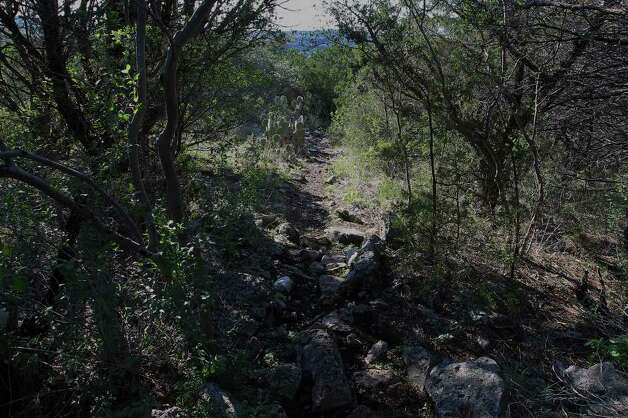 A rocky trail leading toward the South Bluff Spurs Overlook at Government Canyon State Park on Tuesday, Dec. 6, 2011. Addressing media at Government Canyon State Park, Carter Smith, Texas Parks and Wildlife excecutive director, made a plea for for people to use the state parks and for donations. Stricken by drought and wildfires this past year, state parks have suffered from the lack of visitors. Smith said revenues have declined 25 percent from last year. Kin Man Hui/kmhui@express-news.net Photo: KIN MAN HUI, SAN ANTONIO EXPRESS-NEWS / SAN ANTONIO EXPRESS-NEWS