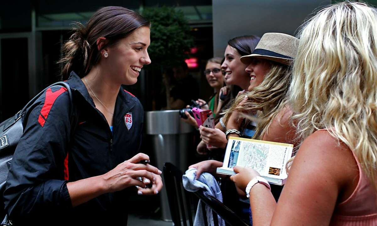 Alex Morgan greets fans after she and other members of the U.S. soccer team arrived in New York's Times Square on Monday, July 18, 2011, the day after the team's loss to Japan in the Women's World Cup final in Germany.
