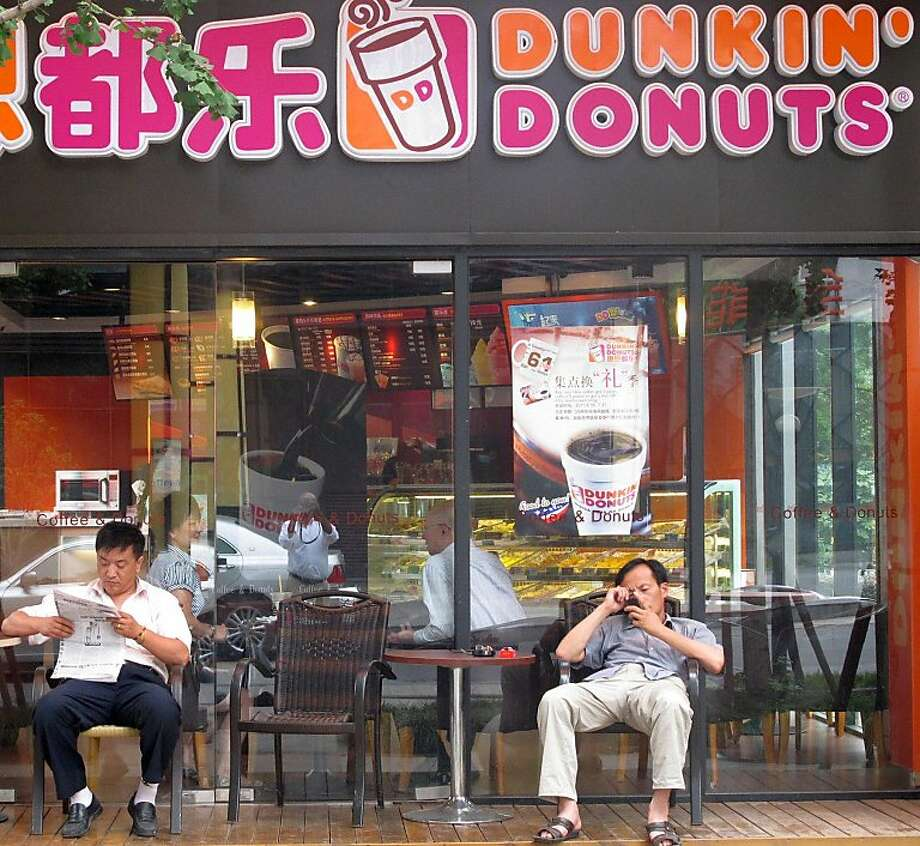 Dunkin' Donuts hopes to have 100 shops across China within 10 years. But what isnt at all clear is whether Chinese consumers particularly like doughnuts. A store in Shanghai. Illustrates CHINA-DOUGHNUT (category i), by Keith B. Richburg (c) 2011, The Washington Post. Moved Tuesday, July 19, 2011. (MUST CREDIT: Washington Post photo by Keith B. Richburg.) Photo: Post, The Washington Post